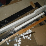 Excess foam removed, blade split in two, and groove cut for board.